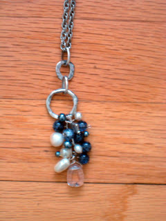 Necklace of my own design made from an old bracelet, chain, and a variety of of blue white and clear beads.