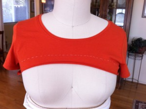 Too tight t-shirt cut just below the armholes and curved over the bustline